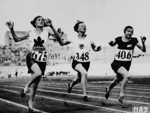 Myrtle_Cook_of_Canada_(left)_winning_a_preliminary_heat_in_the_womens_100_metres_race_at_the_VIIIth_Summer_Olympic_Games