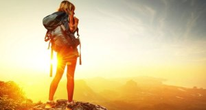 Woman-On-Top-Of-Mountain-At-Sunset-520